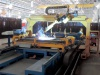 Robotic center for assembly and welding of a dump truck back door